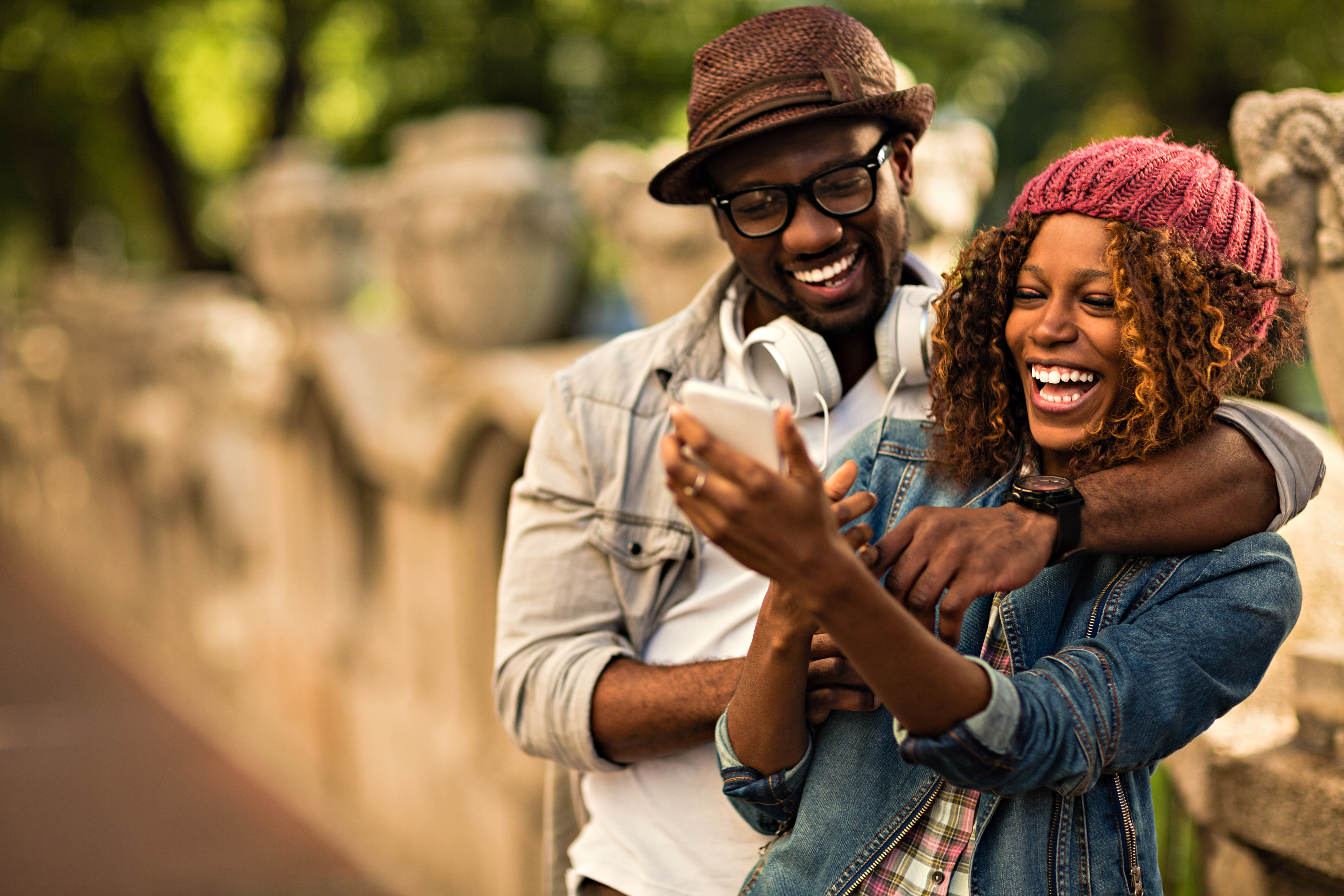 Happy young couple looking at a cell phone